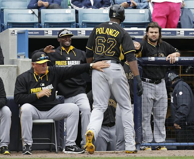 Pittsburgh Pirates right fielder Gregory Polanco (62) is greeted by teammates after hitting a home run during the first inning of an exhibition baseball game against the New York Yankees Thursday, Feb. 27, 2014, in Tampa, Fla. (AP Photo/Charlie Neibergall)