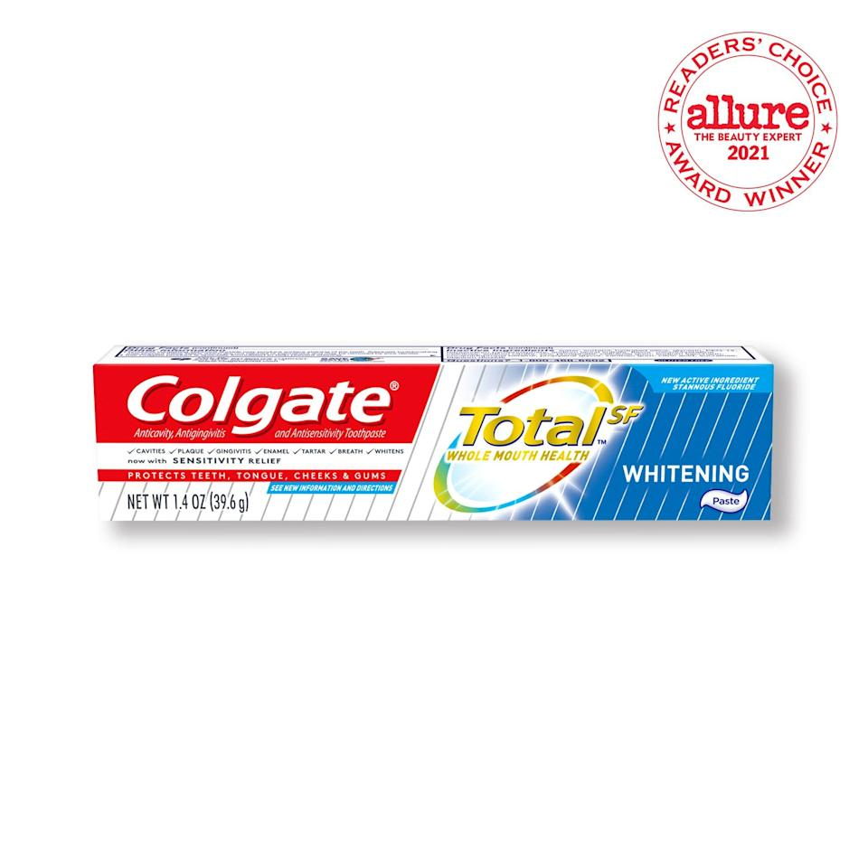 """Few toothpaste brands are more recognizable than Colgate Total. Although there's an extensive lineup, the hydrated-silica-infused Colgate's Total Whitening Toothpaste Gel is one of the most affordable options for removing surface stains. The toothpaste is made with 0.454 percent antimicrobial stannous fluoride, which <a href=""""https://pubmed.ncbi.nlm.nih.gov/15642062/"""" rel=""""nofollow noopener"""" target=""""_blank"""" data-ylk=""""slk:studies say help fight against gingivitis"""" class=""""link rapid-noclick-resp"""">studies say help fight against gingivitis</a>, plaque, and tooth sensitivity — giving your teeth, gums, tongue, and cheeks the <em>total</em> cleansing package. And that's exactly why we found it worthy of a 2021 <em>Allure</em> Readers' Choice Award."""