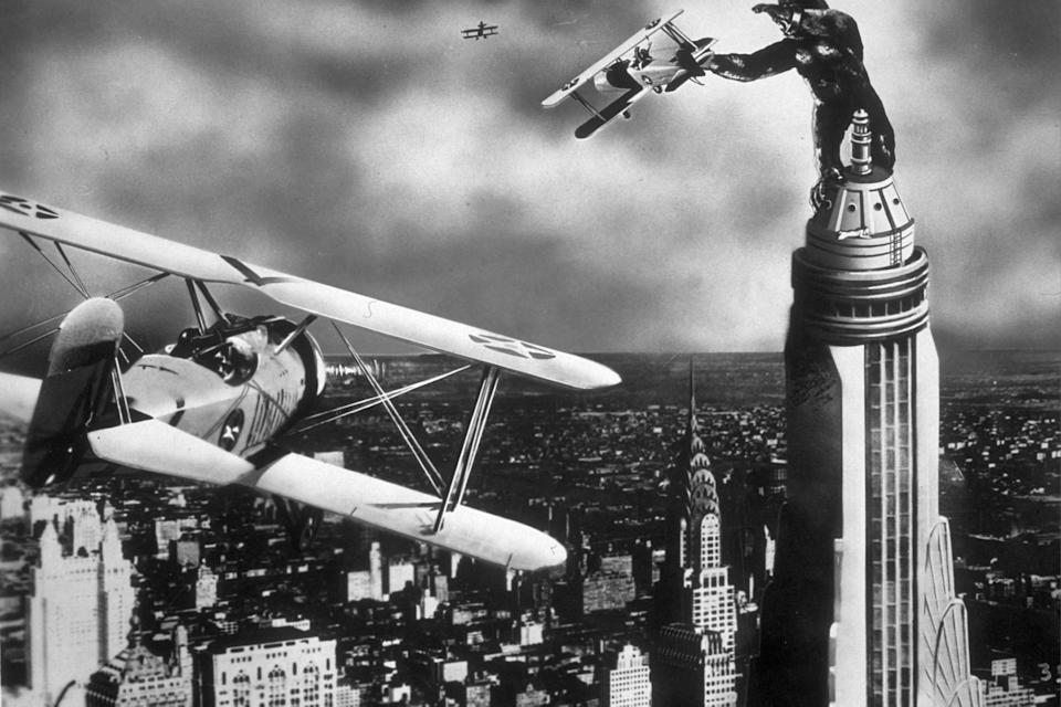 A scene from the film 'King Kong' with the giant gorilla astride a Manhattan skyscraper grabbing a passing aeroplane. The film was directed by Merian C Cooper and Ernest B Schoedsack for RKO.   (Photo by Hulton Archive/Getty Images)