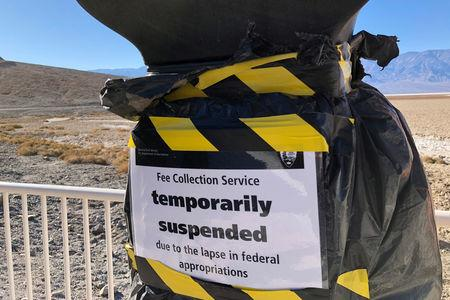 A National Park entrance fee collection service is temporarily suspended at Badwater Basin in Death Valley National Park in California