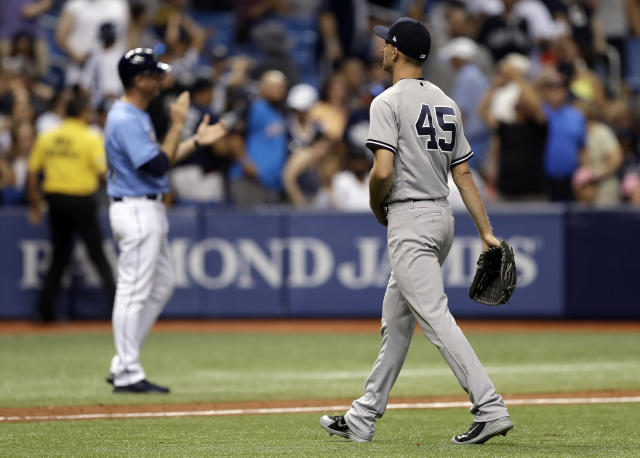 New York Yankees relief pitcher Chasen Shreve (45) walks off after giving up a game-winning home run to Tampa Bay Rays' Jake Bauers during the 12th inning of a baseball game Sunday, June 24, 2018, in St. Petersburg, Fla. The Rays won the game 7-6. (AP Photo/Chris O'Meara)
