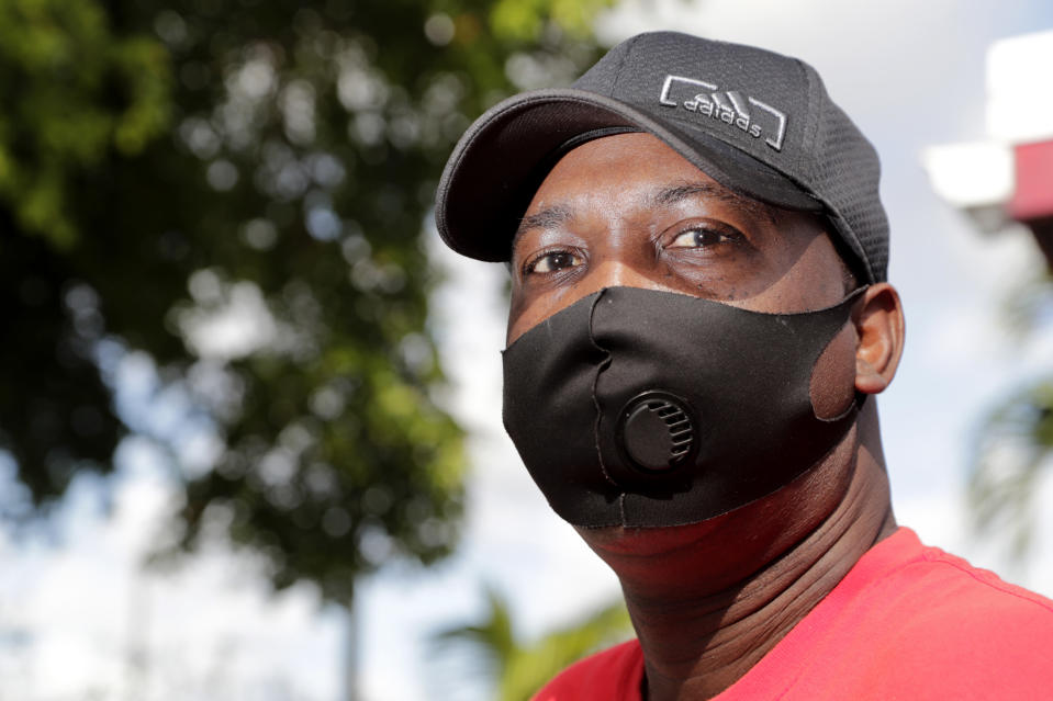 James Jackson poses for a photograph outside his home during the coronavirus pandemic, Thursday, July 30, 2020, in West Park, Fla. Jackson is among the tens of thousands hospitality workers fighting for survival in the age of the pandemic. Jackson's employer, the Diplomat Beach Resort, in Hollywood, Fla., was forced to close in March because of the outbreak. (AP Photo/Lynne Sladky)