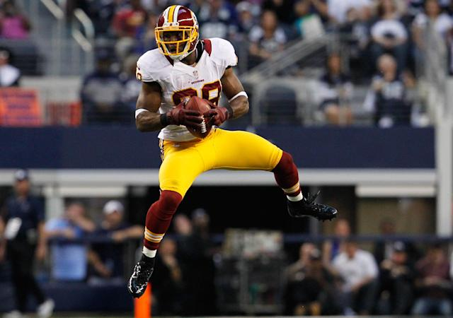 ARLINGTON, TX - NOVEMBER 22: Pierre Garcon #88 of the Washington Redskins pulls in a touchdown pass against the Dallas Cowboys on Thanksgiving Day at Cowboys Stadium on November 22, 2012 in Arlington, Texas. (Photo by Tom Pennington/Getty Images)
