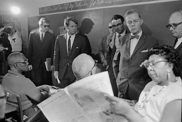 <p>Kennedy and Sen. Joseph Clark, in foreground with bow tie, tour a classroom in Greenville, Miss., April 11, 1967. (Photo: Jack Thornell/AP) </p>
