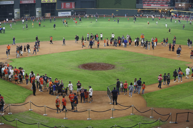Houston Astros fans gather on the field during the baseball team's FanFest at Minute Maid Park on Saturday, Jan. 18, 2020, in Houston. (Steve Gonzales/Houston Chronicle via AP)