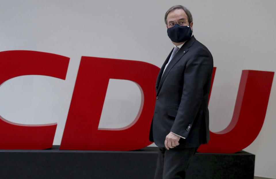 Armin Laschet, chairman of the German Christian Democratic Union, CDU, arrives for a press conference at the party's headquarters in Berlin, Germany, Monday, Jan. 25, 2021. (AP Photo/Michael Sohn, pool)