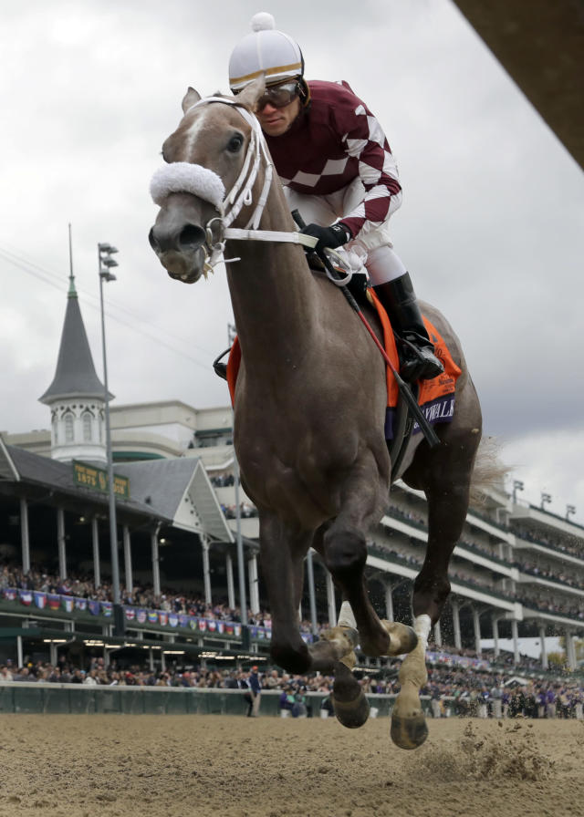 Joel Rosario rides Jaywalk to victory in the Breeders' Cup Juvenile Fillies horse race at Churchill Downs, Friday, Nov. 2, 2018, in Louisville, Ky. (AP Photo/Darron Cummings)