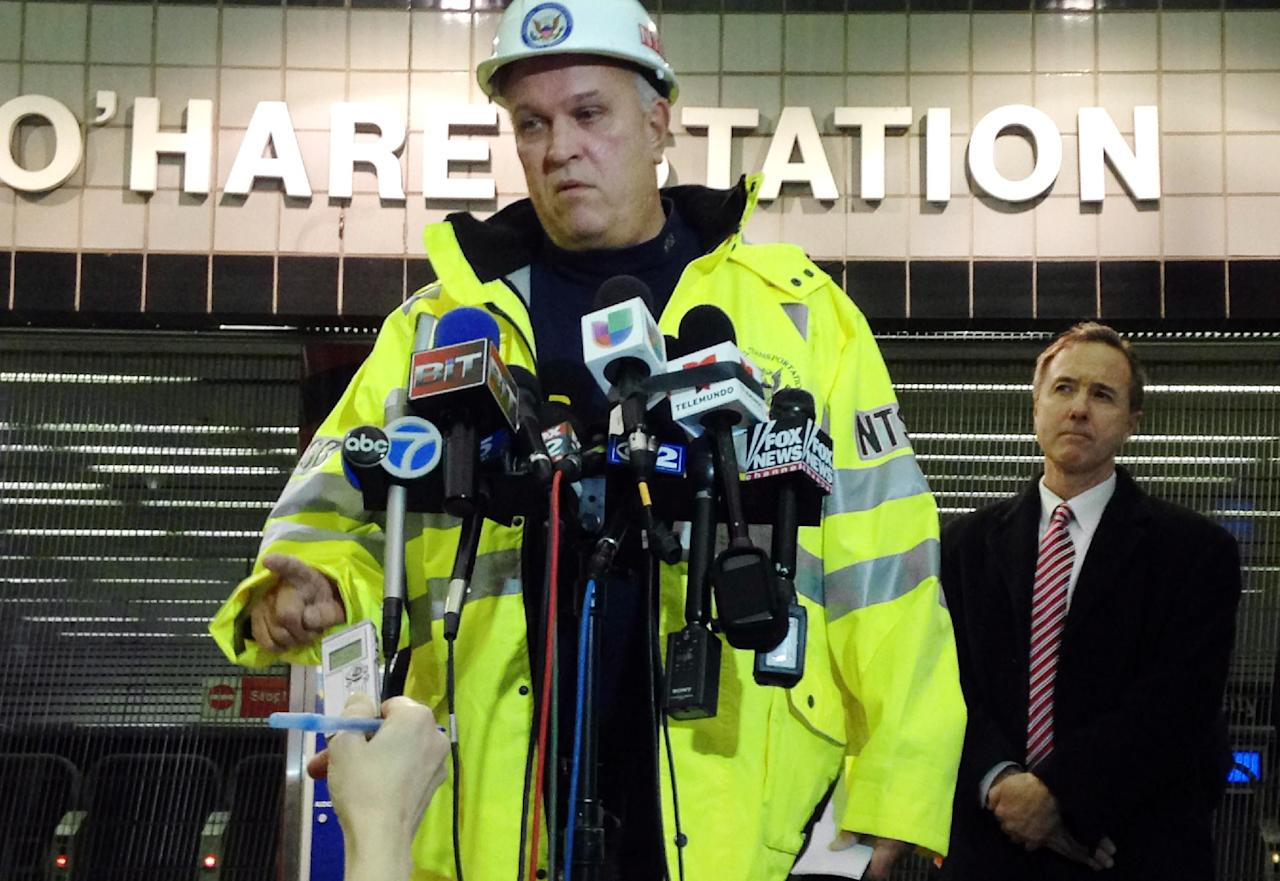 Tim DePaepe, an investigator with the National Transportation Safety Board, accompanied by Chicago Transit Authority President Forrest Claypool, right, speaks during a news conference Monday, March 24, 2014, at Chicago's O'Hare International Airport in Chicago. The NTSB is leading an investigation into why an eight-car Chicago public-transit train jumped the tracks, skidded across a platform and scaled an escalator that leads to one of the nation's busiest airports early Monday, injuring 32 people. (AP Photo/Carla K. Johnson)