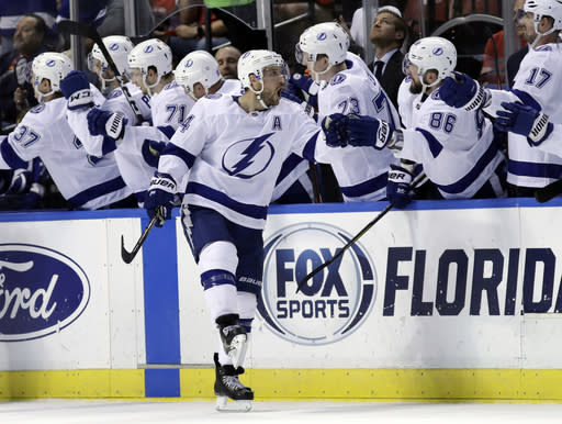 Tampa Bay Lightning right wing Ryan Callahan is congratulated after scoring a goal during the second period of an NHL hockey game against the Florida Panthers, Sunday, Feb. 10, 2019, in Sunrise, Fla. (AP Photo/Lynne Sladky)