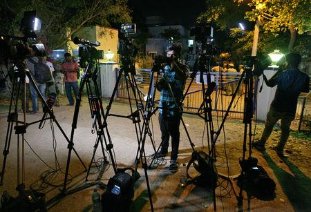 Cameramen work outside the house of an Indian Air Force pilot after he was captured by Pakistan, in the southern city of Chennai, India, February 27, 2019. REUTERS/P. Ravikumar