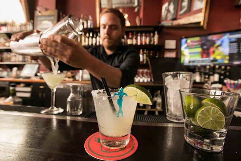 In this Monday, April 28, 2014 photo, bartender Scott Luhrs crafts cocktails at the bar of Luna Park restaurant in Los Angeles. Thousands of restaurateurs from coast to coast who have fallen victim to the Great Green Citrus Crisis of 2014. The price of a lime has skyrocketed in recent weeks, quadrupling or, in some areas, going even higher. (AP Photo)