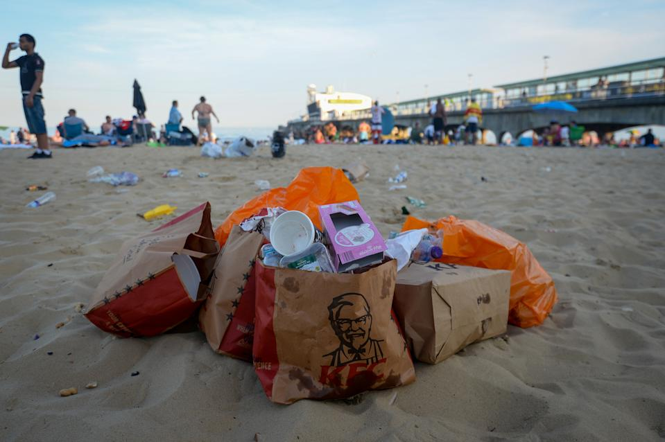 KFC and supermarket packaging is left in a pile on Bournemouth Beach on Thursday afternoon. (Getty)