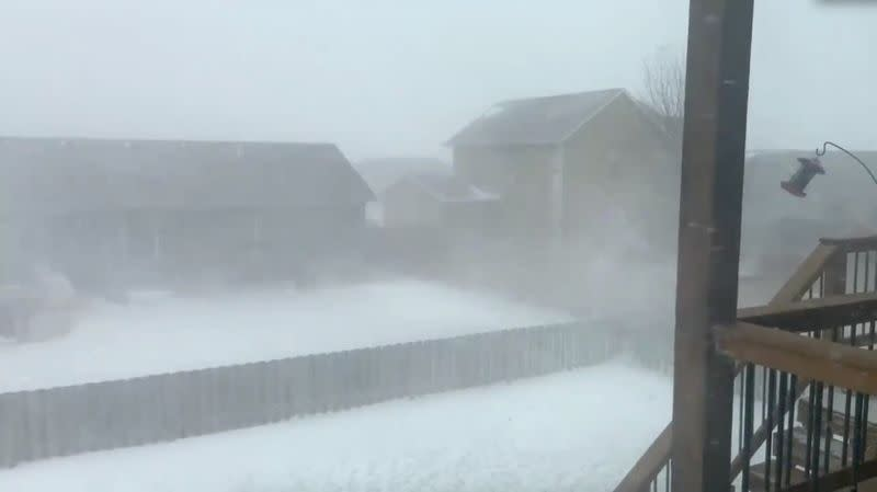 A blizzard is seen in the backyard of a property in Sioux Falls, South Dakota, U.S. in this still frame obtained from social media vide