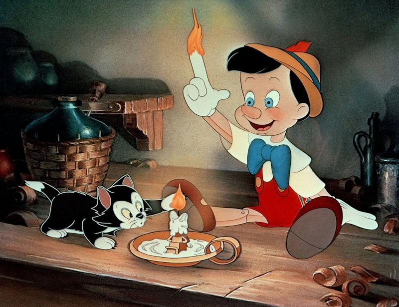 Pinocchio lights his finger on fire in 'Pinocchio' (Photo: Walt Disney/courtesy Everett Collection)