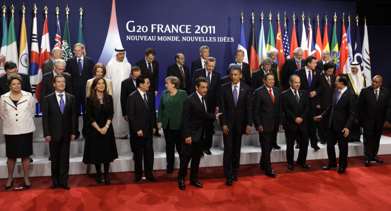 World leaders pose for the group photo for the G20 summit in Cannes,  Thursday Nov.3, 2011. First row from the left are: Brazilian President Dilma Rousseff, Russian President Dmtry Medvedev, Argentinian President Cristina Fernandez Kirchner, China's President Hu Jintao, German Chancellor Angela Merkel, French President Nicolas Sarkozy, U.S President Barack Obama, Indonesia's President Susilo Bambang Yudhoyono, Mexican President Felipe Calderon, OECDSecretary General Angel Gurria, South Korean President Lee Myung-bak, South African President Jacob Zuma. (AP Photo/Markus Schreiber)