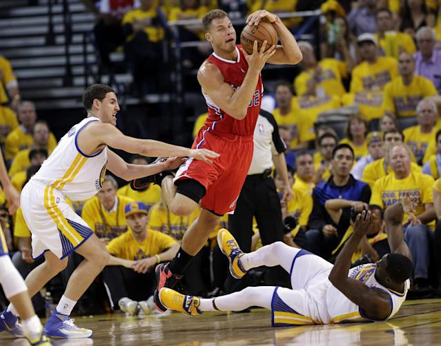 Los Angeles Clippers' Blake Griffin (32) center, is defended by Golden State Warriors' Klay Thompson, left, and Draymond Green during the second half in Game 6 of an opening-round NBA basketball playoff series on Thursday, May 1, 2014, in Oakland, Calif. Golden State won 100-99. (AP Photo/Marcio Jose Sanchez)
