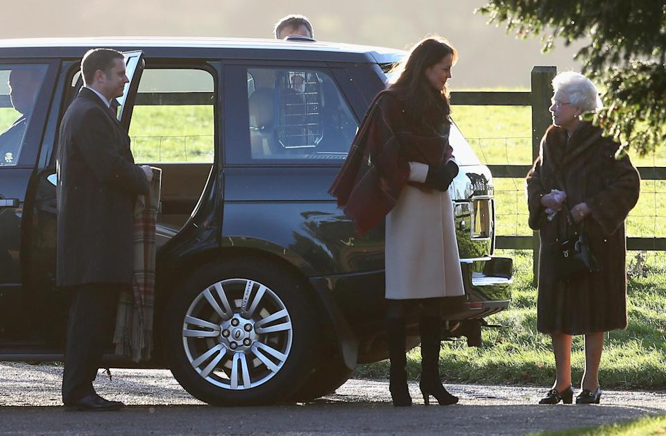 <p>Kate was spotted with the Royal Family for the early morning church service in 2013, wearing a cream coat, a tartan wrap from Really Wild and her Aquatalia 'Rhumba' boots. (Getty) </p>