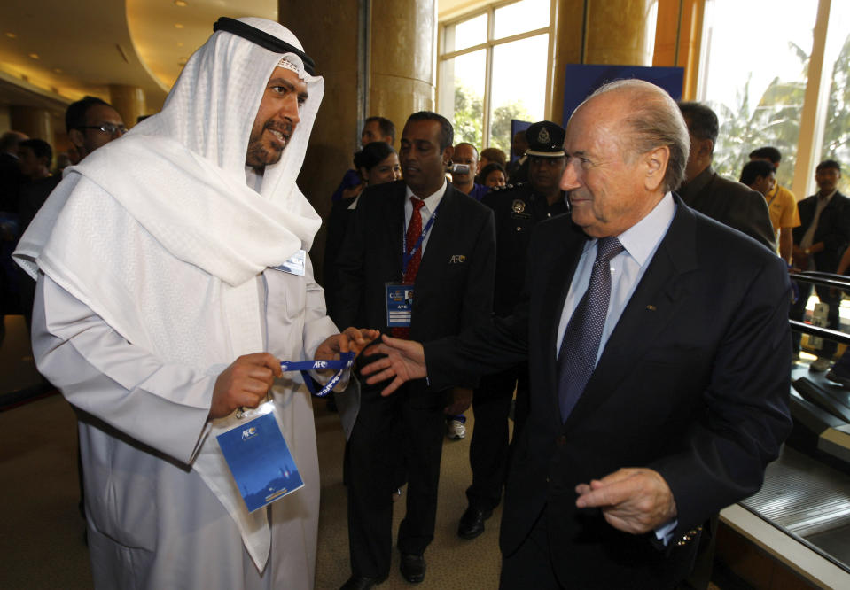FILE - In this Friday, May 8, 2009 file photo, Sheikh Ahmad al-Fahad al-Sabah from Kuwait speaks with FIFA President Sepp Blatter during the 23rd AFC Congress at a hotel in downtown Kuala Lumpur, Malaysia. Olympic powerbroker Sheikh Ahmad al-Fahad al-Sabah will go on trial in Switzerland this month accused of forgery in a case linked to political rivalry in Kuwait's royal family. Lawyers for the sheikh say he will attend the hearing listed by a criminal court in Geneva to run from Feb. 22-26, 2021. (AP Photo/Mark Baker, file)