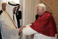 Saudi Arabia's King Abdullah is greeted by Pope Benedict XVI on his arrival for their meeting at the Vatican November 6, 2007. REUTERS/Chris Helgren