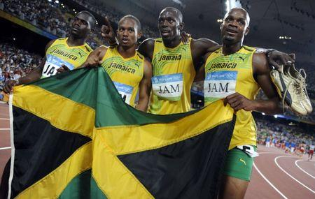 Men's 4x100m relay Asafa Powell, Usain Bolt, Michael Frater, Nesta Carter of Jamaica celebrate after winning the final of the athletics competition in the National Stadium during the Beijing 2008 Olympic Games August 22, 2008.  REUTERS/Kai Pfaffenbach/Files
