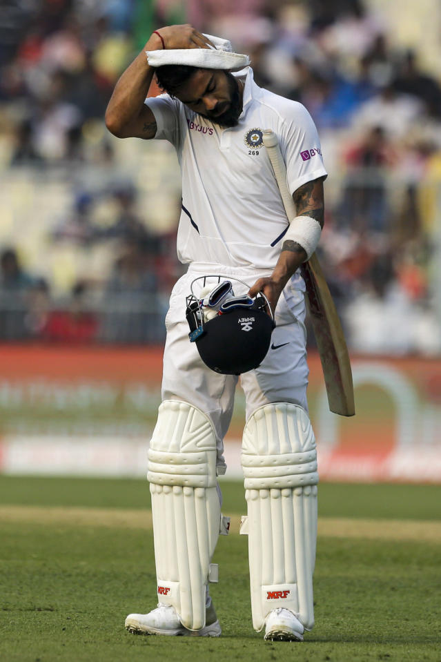 India's Virat Kohli wipes his head with a towel during a break on the second day of the second test cricket match between India and Bangladesh, in Kolkata, India, Saturday, Nov. 23, 2019. (AP Photo/Bikas Das)