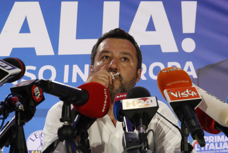 Italian Interior Minister and Deputy Premier Matteo Salvini, of the League kisses a crucifix as as he talks to reporters during a press conference at the League headquarters in Milan, Italy, early Monday morning, May 27, 2019. (AP Photo/Antonio Calanni)