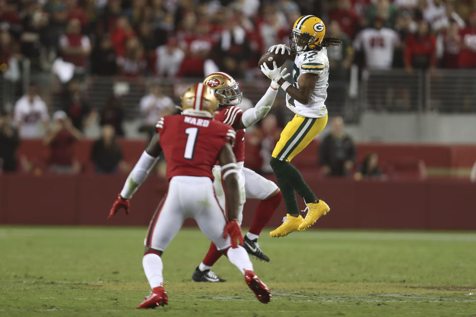 Green Bay Packers wide receiver Davante Adams, right, catches a pass against San Francisco 49ers middle linebacker Fred Warner, rear, and cornerback Jimmie Ward (1) during the second half of an NFL football game in Santa Clara, Calif., Sunday, Sept. 26, 2021. (AP Photo/Jed Jacobsohn)