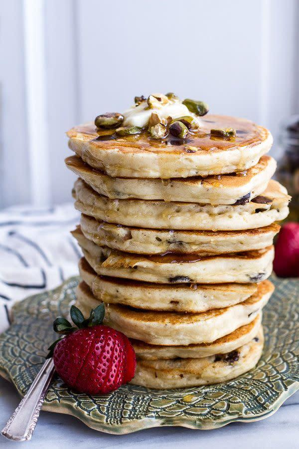 "<strong>Get the <a href=""http://www.halfbakedharvest.com/chocolate-chip-lemon-baklava-pancakes-salted-vanilla-honey-syrup/"" rel=""nofollow noopener"" target=""_blank"" data-ylk=""slk:Chocolate Chip Lemon Baklava Pancakes with Salted Vanilla Honey Syrup recipe"" class=""link rapid-noclick-resp"">Chocolate Chip Lemon Baklava Pancakes with Salted Vanilla Honey Syrup recipe</a> from Half Baked Harvest</strong>"
