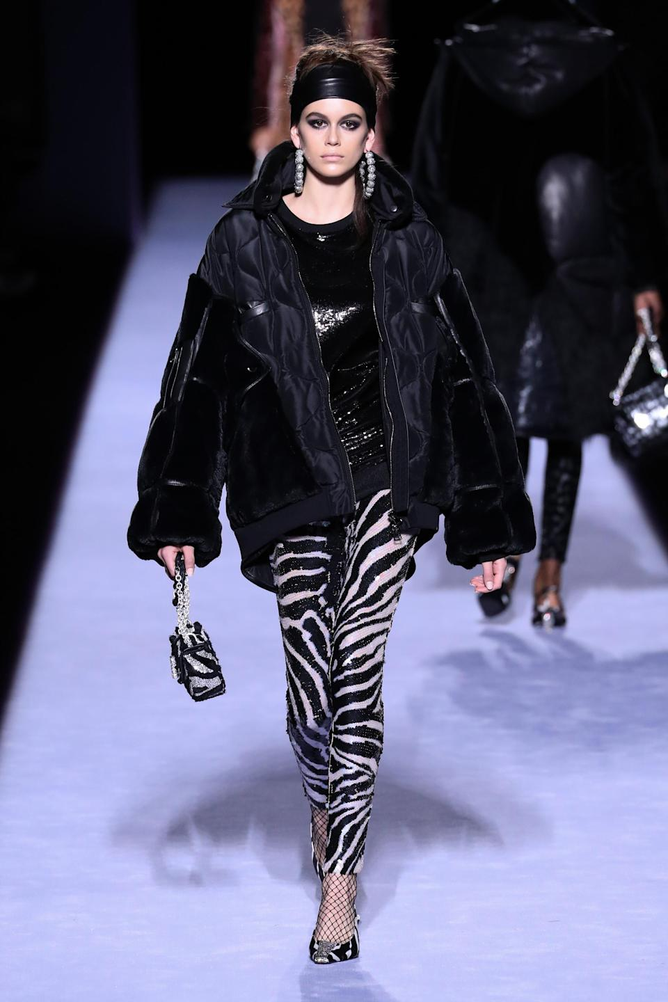 <p>Cindy Crawford's daughter walked a HUGE pair of earrings down the runway, while wearing a pair of zebra print trousers and carrying a matching bag. <em>[Photo: Getty]</em> </p>