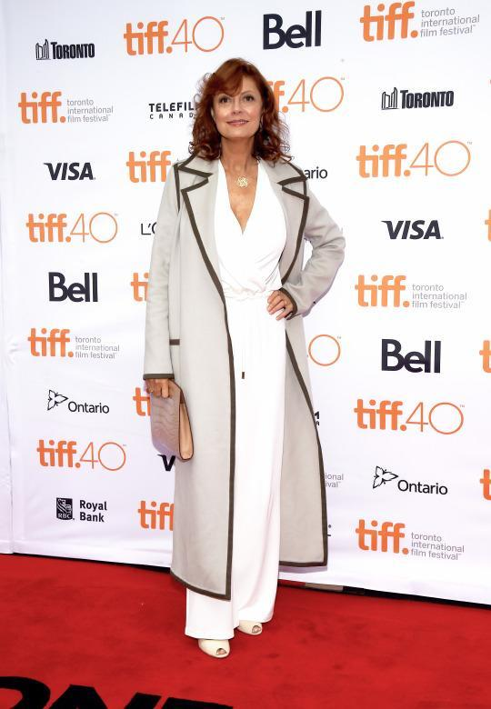 "<p>Susan Sarandon posed on the red carpet at the ""About Ray"" premiere in a white jumpsuit, which she covered up with a trench coat.</p>"