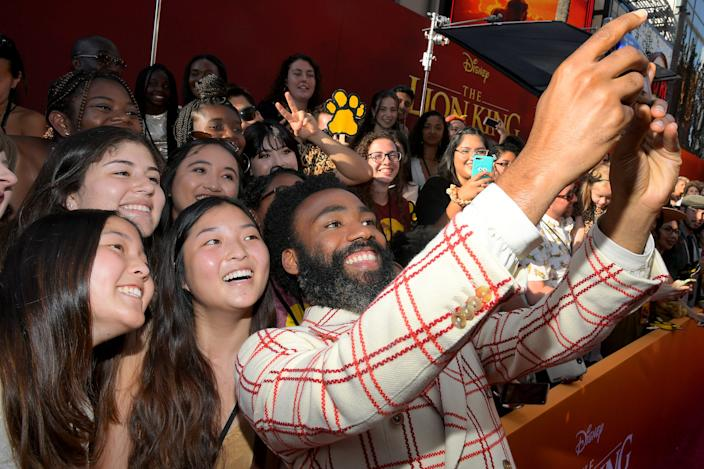 Donald Glover takes selfies with fans at the world premiere of