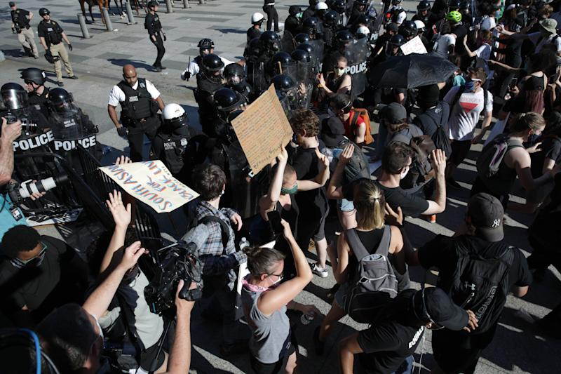 Demonstrators, gathered at Lafayette Park across from the White House on May 30, 2020, attempt to breach a police barricade during a protest.
