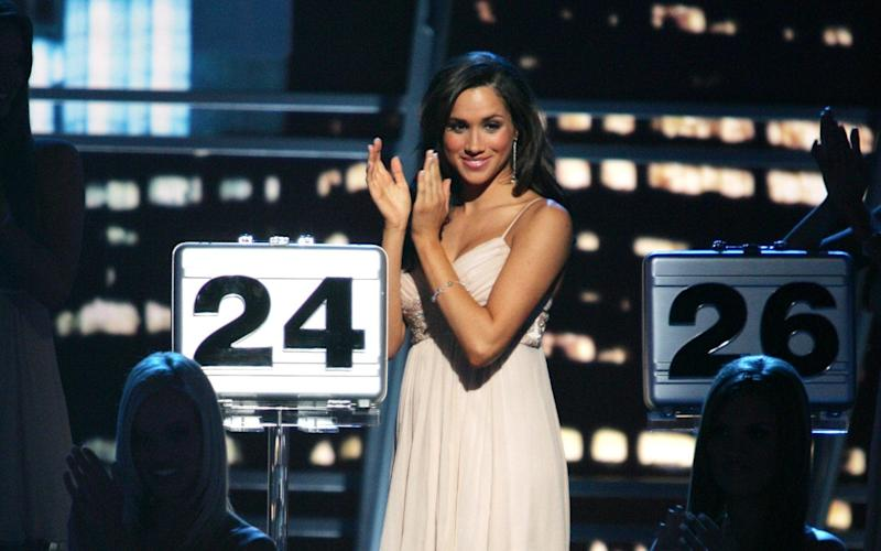 Meghan Markle during her stint as a briefcase model on the US version of Deal or No Deal - NBC/NBCUniversal