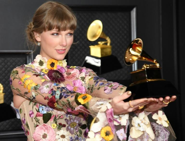 """Taylor Swift became the first woman to win the coveted Album of the Year prize three times, for the first of her twin quarantine albums, """"folklore"""""""