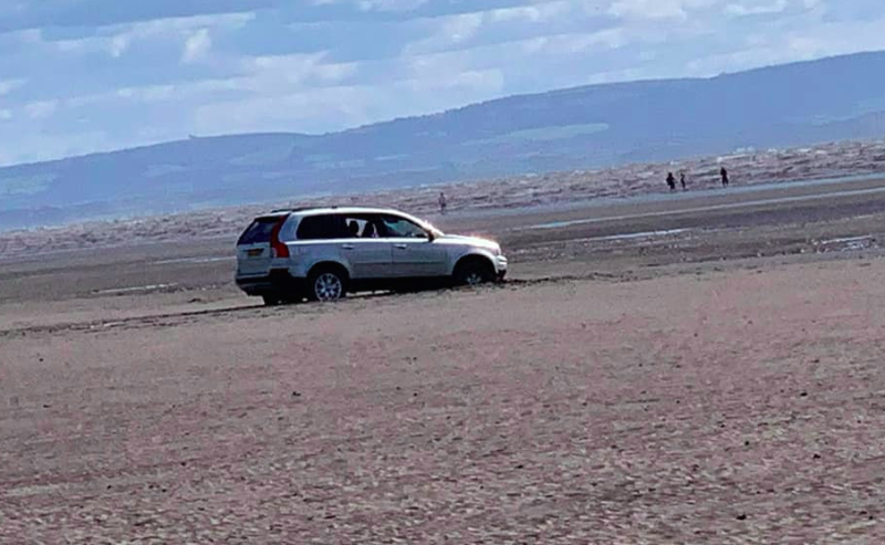 A couple's car was stranded after they tried to park close to the sea at Burnham-on-Sea, Somerset (SWNS)