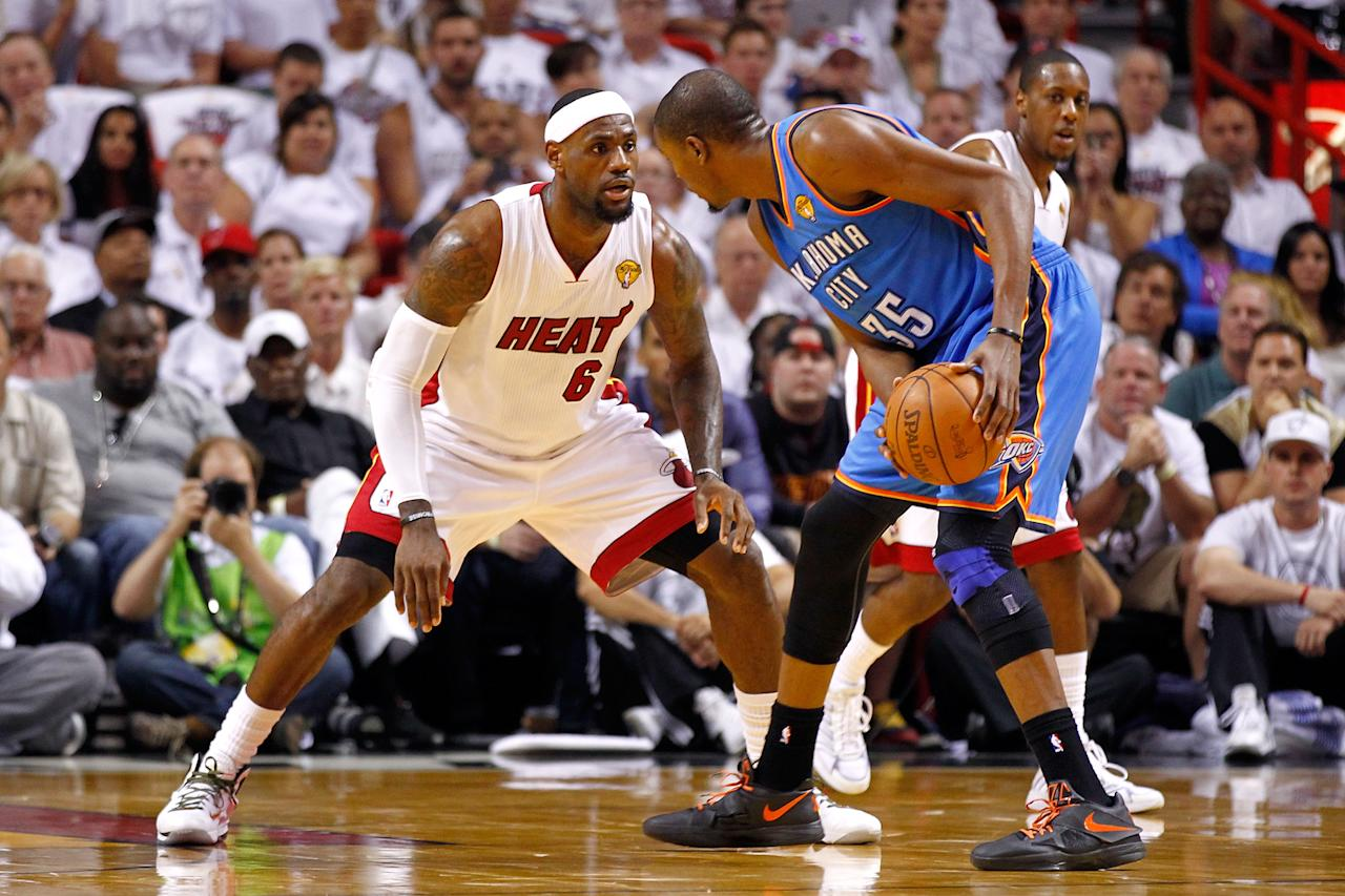 MIAMI, FL - JUNE 17:  LeBron James #6 of the Miami Heat defends in the first quarter against Kevin Durant #35 of the Oklahoma City Thunder in Game Three of the 2012 NBA Finals on June 17, 2012 at American Airlines Arena in Miami, Florida.  NOTE TO USER: User expressly acknowledges and agrees that, by downloading and or using this photograph, User is consenting to the terms and conditions of the Getty Images License Agreement.  (Photo by Mike Ehrmann/Getty Images)