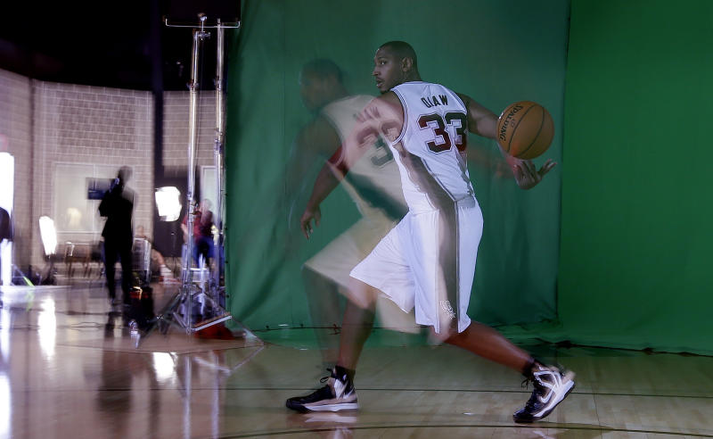 In this timed exposed photo, San Antonio Spurs' Boris Diaw, of France, poses for a photo at the team's workout facility during their NBA basketball media day, Monday, Sept. 30, 2013, in San Antonio. (AP Photo/Eric Gay)