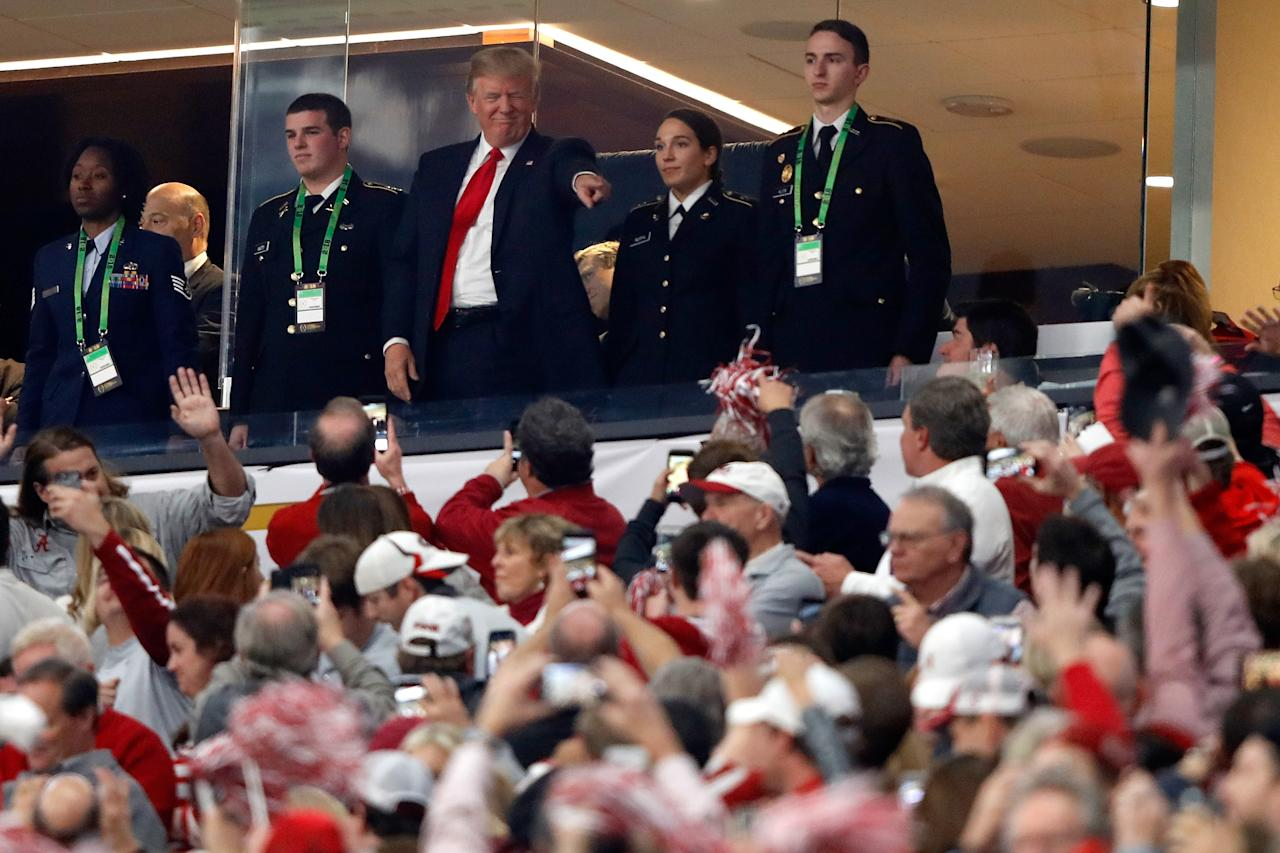 <p>U.S. President Donald Trump points to fans prior to the CFP National Championship presented by AT&T between the Georgia Bulldogs and the Alabama Crimson Tide at Mercedes-Benz Stadium on January 8, 2018 in Atlanta, Georgia. (Photo by Jamie Squire/Getty Images) </p>