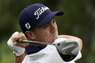 FILE - In this June 3, 2021, file photo, Justin Thomas watches his drive on the 11th hole during the first round of the Memorial golf tournament in Dublin, Ohio. (AP Photo/Darron Cummings, File)