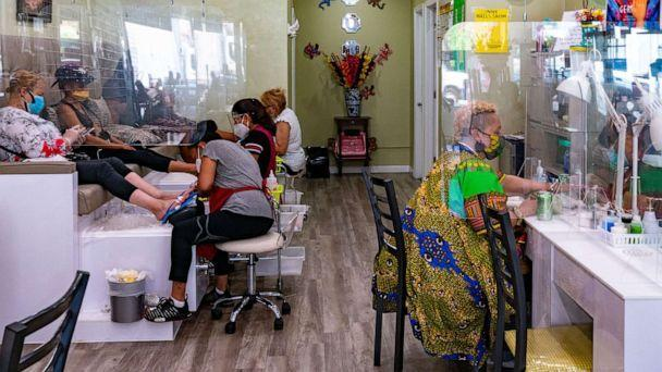 PHOTO: Customers have their nails done at Conny Nail Salon on July 6, 2020, in New York. (David Dee Delgado/Getty Images)