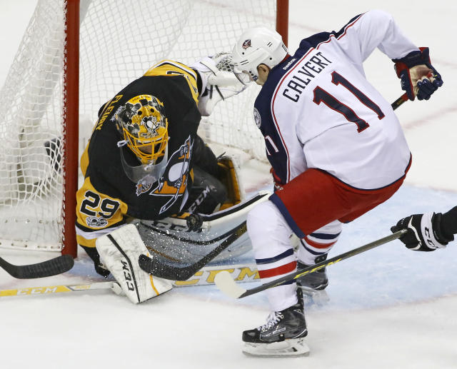 Pittsburgh Penguins goalie Marc-Andre-Fleury (29) stops a shot by Columbus Blue Jackets Matt Calvert (11) during the first period in Game 5 of an NHL first-round hockey playoff series in Pittsburgh, Thursday, April 20, 2017. (AP Photo/Gene J. Puskar)