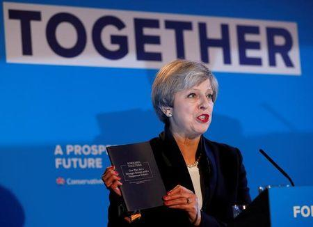 UK's Theresa May vows to cut immigration, build 'great meritocracy'