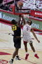 Arkansas defender Moses Moody (5) blocks the shot of Missouri forward Jeremiah Tilmon (23) during the first half of an NCAA college basketball game in Fayetteville, Ark. Saturday, Jan. 2, 2021. (AP Photo/Michael Woods)