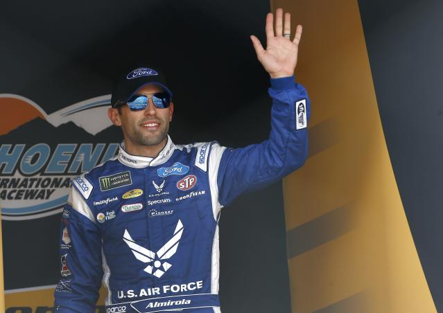 "<a class=""link rapid-noclick-resp"" href=""/nascar/sprint/drivers/1361/"" data-ylk=""slk:Aric Almirola"">Aric Almirola</a> waves to the crowd during driver introductions prior to a NASCAR Cup Series auto race at Phoenix International Raceway Sunday, Nov. 12, 2017, in Avondale, Ariz. (AP Photo/Ross D. Franklin)"