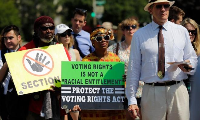 Supporters of the Voting Rights Act listen to speakers outside the U.S. Supreme Court after Tuesday's ruling.