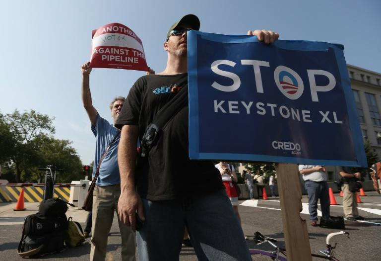 Activists stage a protest against the Keystone XL pipeline outside the US State Department in Washington in August 2013