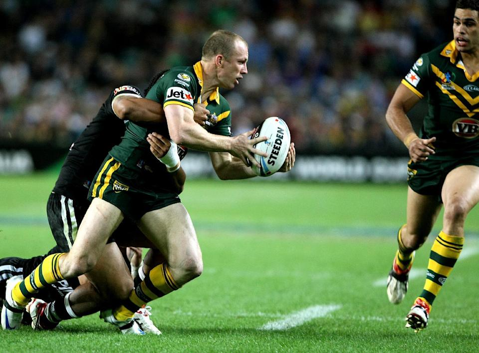 File picture for illustration shows a player passing the ball during a rugby league match in Sydney on October 26, 2008 (AFP Photo/Greg Wood)