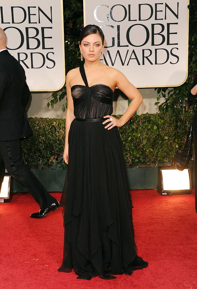Mila Kunis arrives at the 69th Annual Golden Globe Awards in Beverly Hills, California, on January 15.