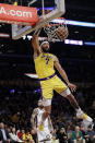 Los Angeles Lakers' JaVale McGee (7) dunks against the Brooklyn Nets during the first half of an NBA basketball game Tuesday, March 10, 2020, in Los Angeles. (AP Photo/Marcio Jose Sanchez)
