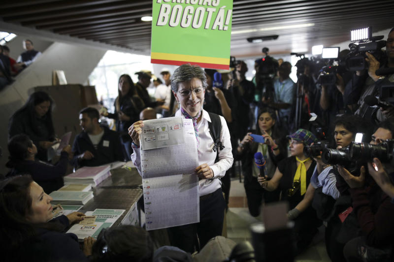 Claudia Lopez, candidate for Mayor of Bogota for the Green Alliance, shows her ballot before voting during local and regional elections in Bogota, Colombia, Sunday, Oct. 27, 2019. Colombians went to the polls Sunday to choose mayors, state governors and local assemblies. (AP Photo/Ivan Valencia)